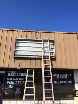 Electric Building Sign Installation